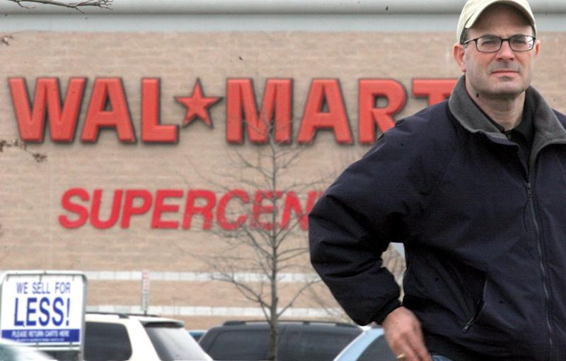 "Charles Fishman has just written a book called ""The Wal-Mart Effect."" For this picture he is standing outside a WAL*MART SUPERCENTER at the Center of Hagerstown, a long strip mall shopping center in Hagerstown, Md. (Photo by Rich Lipski/The Washington Post/Getty Images)"