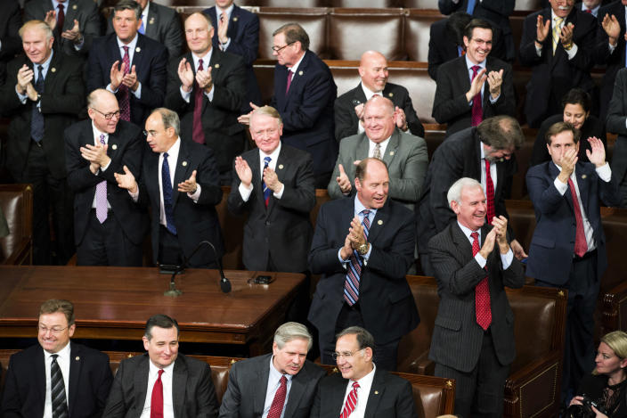 Republican lawmakers applaud after an objection to a ballot count was overturned during a joint session of Congress to count Electoral College votes in Washington, Friday, Jan. 6, 2017. Congress certified Donald Trump's presidential victory over the objections of a handful of House Democrats, with Vice President Joe Biden pronouncing,