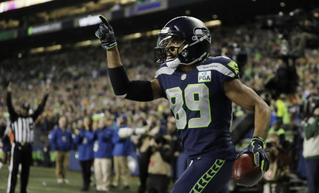 Seattle Seahawks wide receiver Doug Baldwin celebrates after catching a pass for a touchdown against the Green Bay Packers during the first half of an NFL football game Thursday, Nov. 15, 2018, in Seattle. (AP Photo/Stephen Brashear)