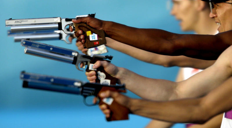 FILE - In this Saturday, Aug. 11, 2012 file photo competitors take aim in the combination running and shooting stage of the men's modern pentathlon at the 2012 Summer Olympics in London. Removing a sport from the Olympics is one of the IOC's most delicate and sensitive tasks. After months of evaluation, a decision will come next week _ and the century-old competition of modern pentathlon appears the most at risk. The IOC executive board will meet in Lausanne, Switzerland, and announce Tuesday which of the current 26 sports on the Olympic program will be dropped for the 2020 Games.(AP Photo/David Goldman, File)