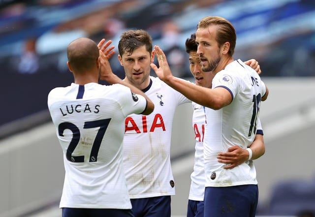 Ben Davies, centre, wants to see Harry Kane, right, stay at Tottenham