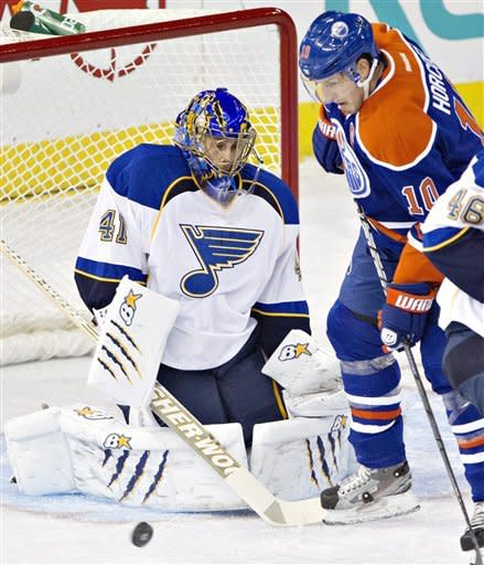 St. Louis Blues goalie Jaroslav Halak, 41, makes the save on Edmonton Oilers' Shawn Horcoff, 10, during first period NHL hockey action in Edmonton, Alberta, on Saturday March 23, 2013. (AP Photo/The Canadian Press, Jason Franson)