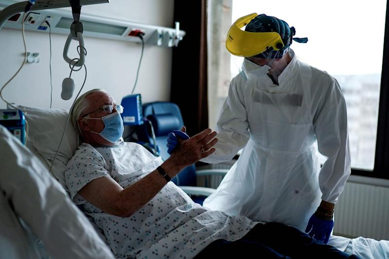 Doctor speaks to patient in the coronavirus unit at the Erasme Hospital in Brussels: AFP via Getty Images