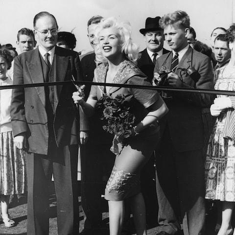 Actress Jayne Mansfield cutting the tape to open the new Chiswick fly-over road, England, September 30th 1959. (Photo by Central Press/Hulton Archive/Getty Images) - Credit: Central Press/Hulton Archive/Getty Images