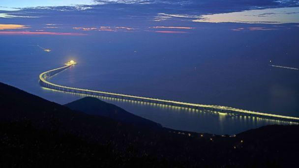 PHOTO: The Hong Kong-Zhuhai-Macau Bridge is lit up in Hong Kong, Oct. 21, 2018. The bridge, the world's longest cross-sea project, which has a total length of 34 miles, will have opening ceremony in Zhuhai on Oct. 23. (Vincent Yu/AP)