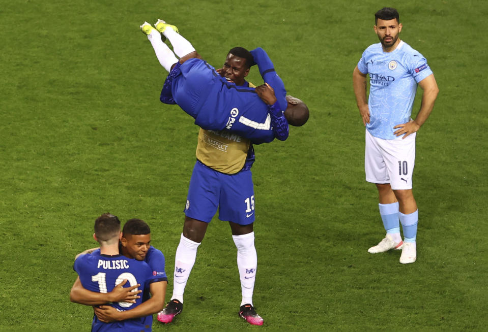 Chelsea players celebrate after winning the Champions League final soccer match against Manchester City at the Dragao Stadium in Porto, Portugal, Saturday, May 29, 2021. (Michael Steele/Pool via AP)