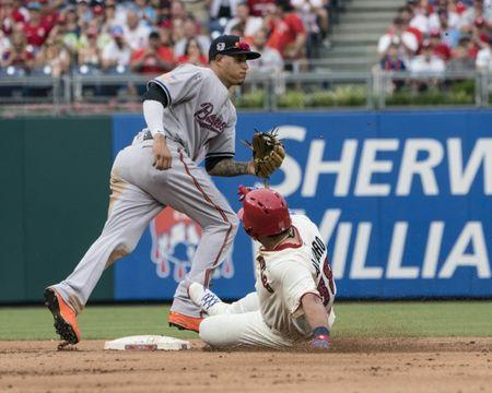 Jul 4, 2018; Philadelphia, PA, USA; Philadelphia Phillies catcher Jorge Alfaro (38) slides safely into second base with a double and Baltimore Orioles Shortstop Manny Machado (13) waiting for the throw during the fifth inning of the game against the Baltimore Orioles at Citizens Bank Park. Mandatory Credit: Gregory J. Fisher-USA TODAY Sports