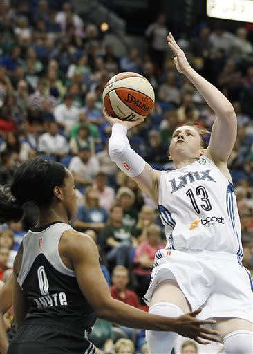 Minnesota Lynx guard Lindsay Whalen (13) falls back for a shot at the basket against San Antonio Silver Stars guard Davellyn White (0) in the first half of a WNBA basketball game, Tuesday, June 11, 2013, in Minneapolis. (AP Photo/Stacy Bengs)