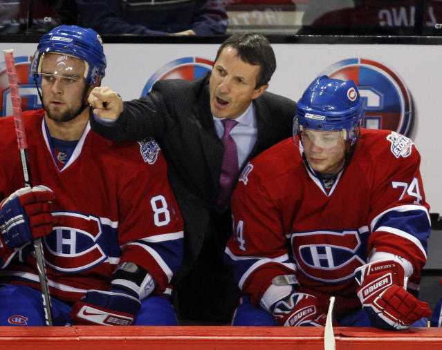 FILE - In this Oct. 4, 2008, file photo, Montreal Canadiens coach Guy Carbonneau, center, argues a call as Guillaume Latendresse, left, and Sergei Kostitsyn, right, look on during the first-period of an NHL preseason hockey game against the Minnesota Wild, in Montreal. Carbonneau was elected to the Hockey Hall of Fame, Tuesday, June 25, 2019. (AP Photo/The Canadian Press,Ryan Remiorz, File)