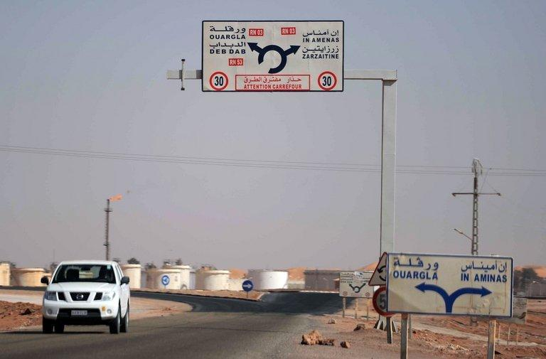 A car drives past an Algerian oil installation on the outskirts of In Amenas near the Libyan border, on January 18, 2013