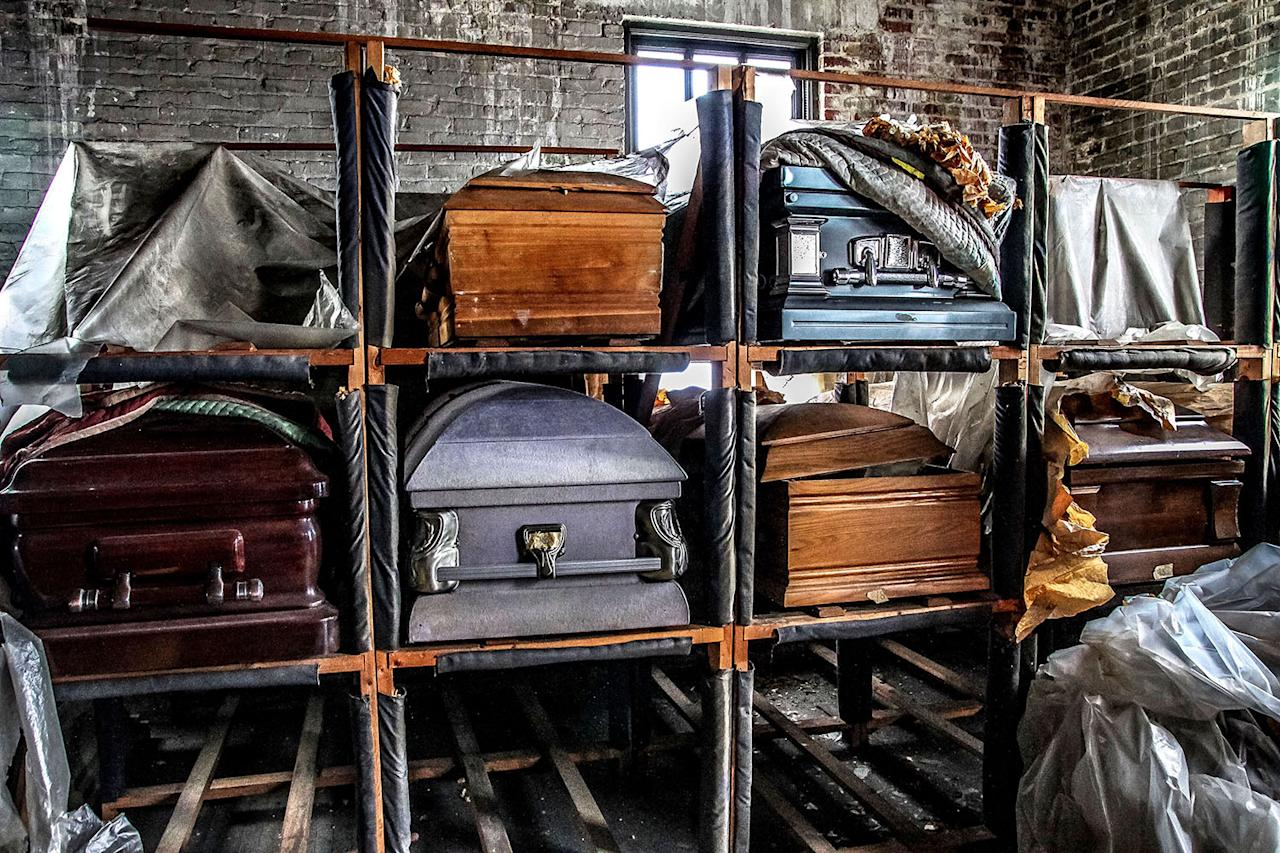 <p>Empty coffins stored away in the abandoned funeral home in Jacksonville, Fla. (Photo: Abandoned Southeast/Caters News) </p>