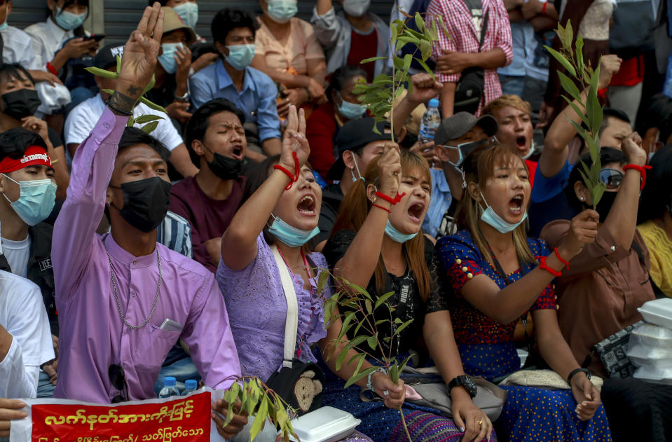 Anti-coup protesters shout slogans in Yangon, Myanmar, Thursday, Feb. 25, 2021. Social media giant Facebook announced Thursday it was banning all accounts linked to Myanmar's military as well as ads from military-controlled companies in the wake of the army's seizure of power on Feb. 1. (AP Photo)