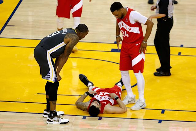 Fred VanVleet immediately hit the ground after taking a hard elbow to the face. (Photo by Lachlan Cunningham/Getty Images)