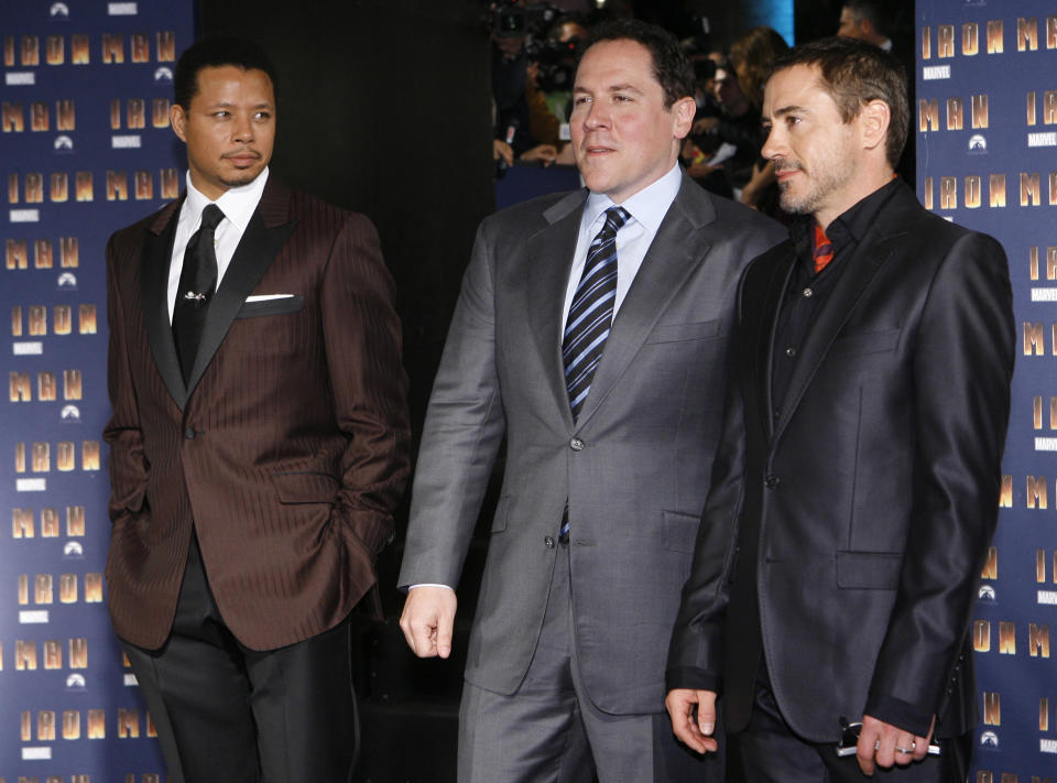 """U.S. actor Terrence Howard, director Jon Favreau and actor Robert Downey Jr. pose for photographers as they arrive for the screening of the movie """"Iron Man"""", in Rome, Wednesday, April 23, 2008.(AP Photo/Alessandra Tarantino)"""
