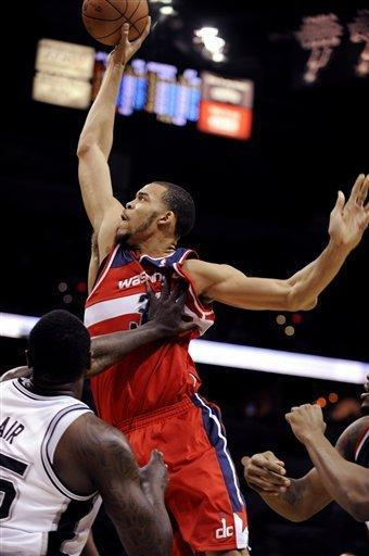 Washington Wizards center JaVale McGee attempts a slam dunk against San Antonio Spurs center DeJuan Blair, left, during the first half of an NBA basketball game, Monday, March 12, 2012 in San Antonio. (AP Photo/Bahram Mark Sobhani)