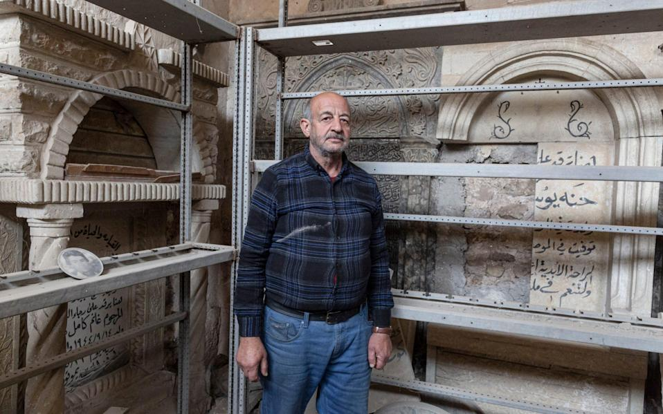 Saadullah Rassam, 63, who claims to be the only Christian currently living in the Old City of Mosul, is photographed inside The Immaculate Syriac Catholic Church, in Mosul, Iraq, on March 4th 2021 - Sam Tarling for the Telegraph