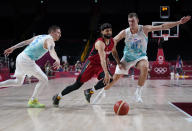Germany's Joshiko Saibou (1), center, and Slovenia's Vlatko Cancar (31), right, chase the loose ball during men's basketball quarterfinal game at the 2020 Summer Olympics, Tuesday, Aug. 3, 2021, in Saitama, Japan. (AP Photo/Charlie Neibergall)