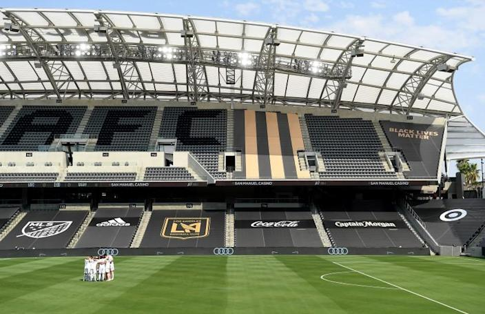 LOS ANGELES, CALIFORNIA AUGUST 22, 2020-Galaxy soccer players gather at an empty stadium before a game against LAFC at Banc of California in Los Angeles Saturday. (Wally Skalij/Los Angeles Times)