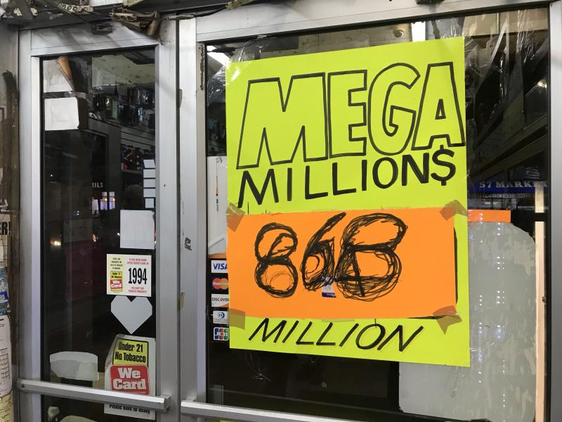 Manhattan Tobacco shop advertises lottery ticket sales Thursday, Oct. 18, 2018 in New York City