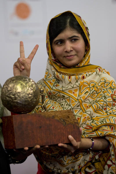 Pakistani teenager Malala Yousafzai, who was shot and injured by the Taliban for advocating girls' education, poses for photographers after being awarded the International Children's Peace Prize 2013 during a ceremony in the Hall of Knights in The Hague, Netherlands, Friday Sept. 6, 2013.(AP Photo/Peter Dejong)