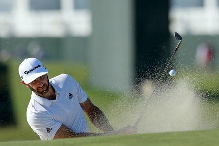 Jun 12, 2018; Southampton, NY, USA; Dustin Johnson hits out of a sand trap onto the 2nd green during Tuesday's practice round of the 118th U.S. Open golf tournament at Shinnecock Hills. Mandatory Credit: Brad Penner-USA TODAY Sports