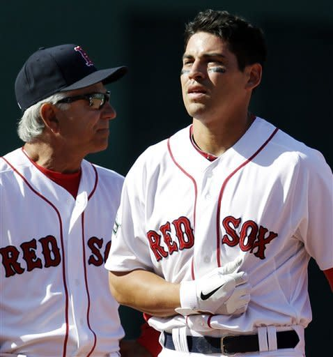 Boston Red Sox's Jacoby Ellsbury leaves the field with manager Bobby Valentine, left, after colliding with Tampa Bay Rays shortstop Reid Brignac while being forced at second base during the fourth inning in a baseball game at Fenway Park in Boston, Friday, April 13, 2012. (AP Photo/Elise Amendola)