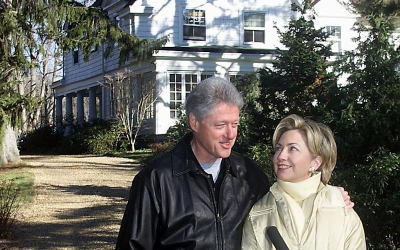 Bill and Hillary Clinton, pictured in 2000 outside their Chappaqua home - AFP