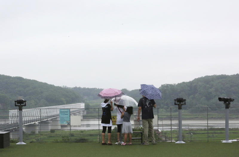 Visitors watch the North Korean side at the Imjingak Pavilion in Paju, near the border with North Korea, South Korea, Wednesday, July 31, 2019. South Korea's military said North Korea conducted its second weapons test in less than a week Wednesday, firing two short-range ballistic missiles off its east coast in a move observers say could be aimed at boosting pressure on the United States as the rivals struggle to set up fresh nuclear talks.(AP Photo/Ahn Young-joon)