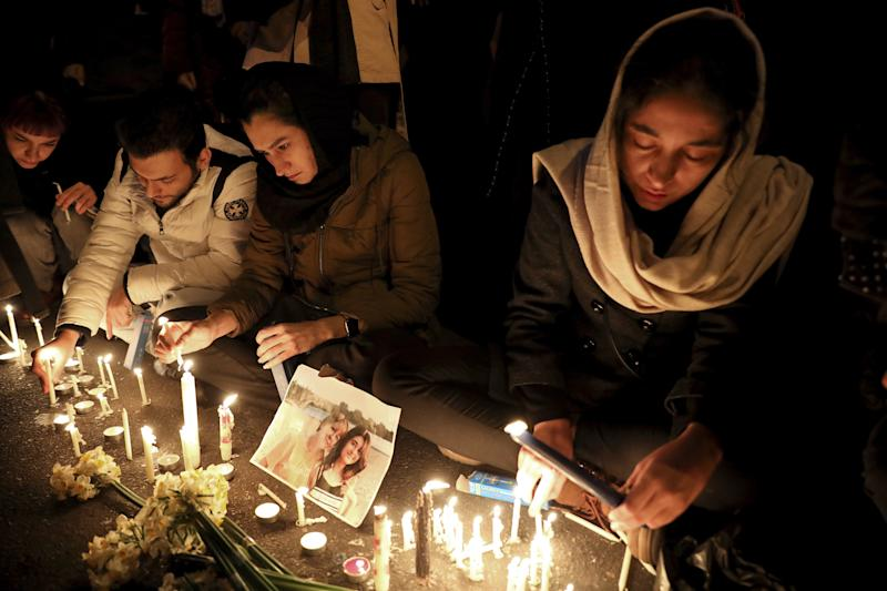 People gather for a candlelight vigil in Tehran