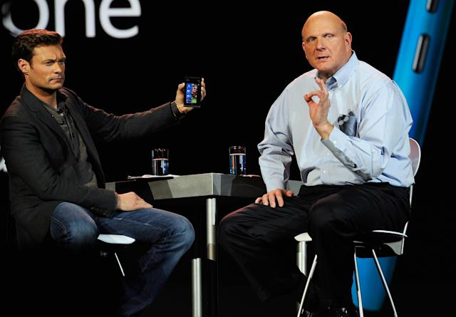 LAS VEGAS, NV - JANUARY 09: Host Ryan Seacrest (L) holds the new Nokia Lumia 900 windows phone during a Microsoft CEO Steve Ballmer's keynote address at the 2012 International Consumer Electronics Show at the Las Vegas Convention Center January 9, 2012 in Las Vegas, Nevada. CES, the world's largest annual consumer technology trade show, runs through January 13 and is expected to feature 2,700 exhibitors showing off their latest products and services to about 140,000 attendees. (Photo by Kevork Djansezian/Getty Images)