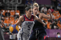 United States' Kelsey Plum (5) drives past Olga Frolkina (15), of the Russian Olympic Committee, during a women's 3-on-3 gold medal basketball game at the 2020 Summer Olympics, Wednesday, July 28, 2021, in Tokyo, Japan. (AP Photo/Jeff Roberson)