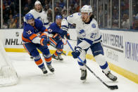 Tampa Bay Lightning defenseman Ryan McDonagh (27) looks to pass as New York Islanders center Mathew Barzal (13) defends during the second period of Game 3 of the NHL hockey Stanley Cup semifinals, Thursday, June 17, 2021, in Uniondale, N.Y. (AP Photo/Frank Franklin II)