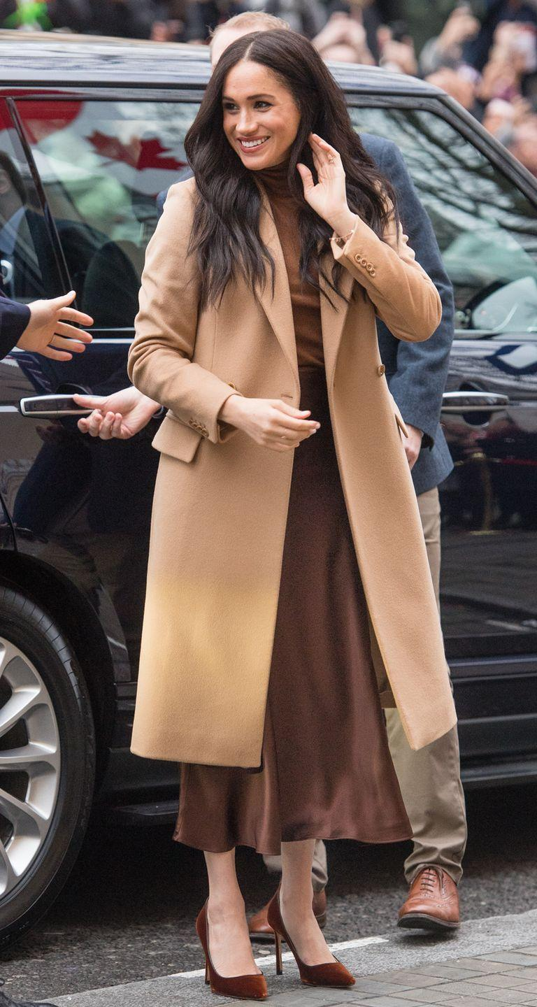 <p>Meghan Markle stepped out in a trendy tonal outfit in January 2020 for her visit to Canada House. The outfit's neutral shades — her camel coat especially — reminds us of Pocahontas's dress. </p>