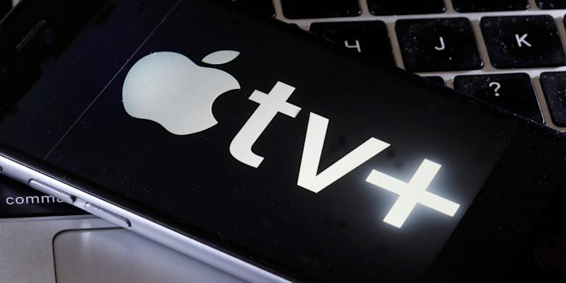 Apple TV Plus logo on an iPhone on a Macbook