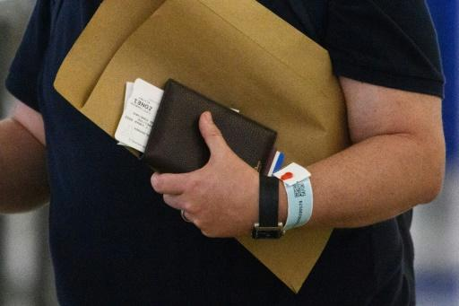 Governments are using various kinds of tracking such as these electronic bracelets in Hong Kong connected to an app to monitor people and curb the spread of COVID-19