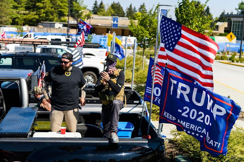 <strong>Proud Boy members at Clackamas Community College in Oregon City last month.</strong> (Photo: ASSOCIATED PRESS)