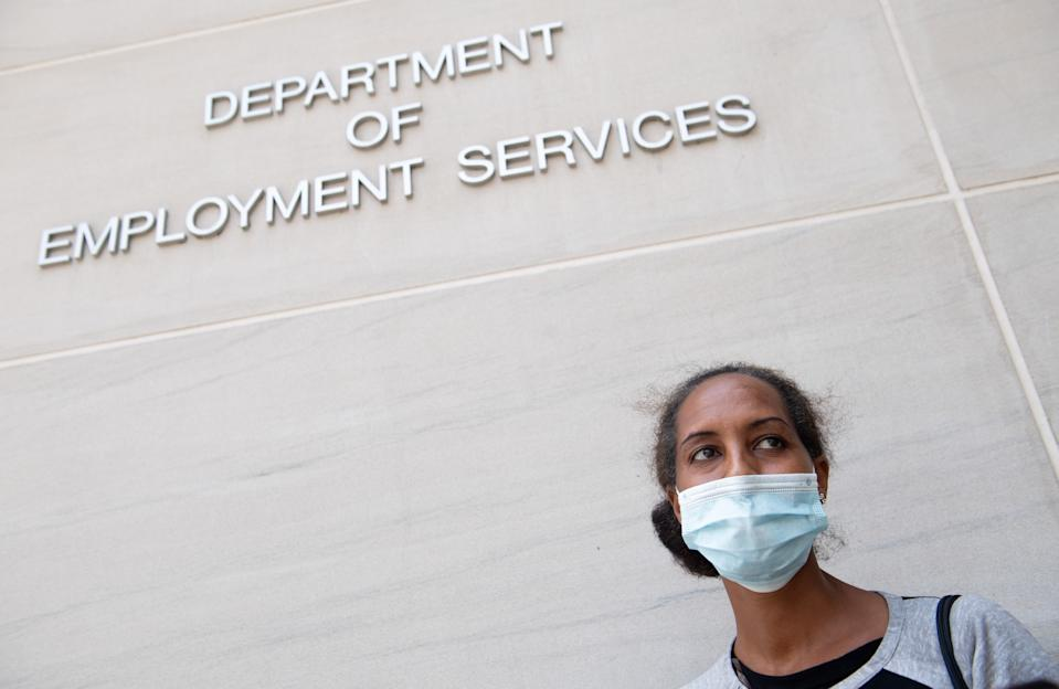 Diana Yitbarek, 44, of Washington, DC, stands outside the DC Department of Employment Services, after trying to find out about her unemployment benefits in Washington, DC, July 16, 2020. (Photo by SAUL LOEB/AFP via Getty Images)