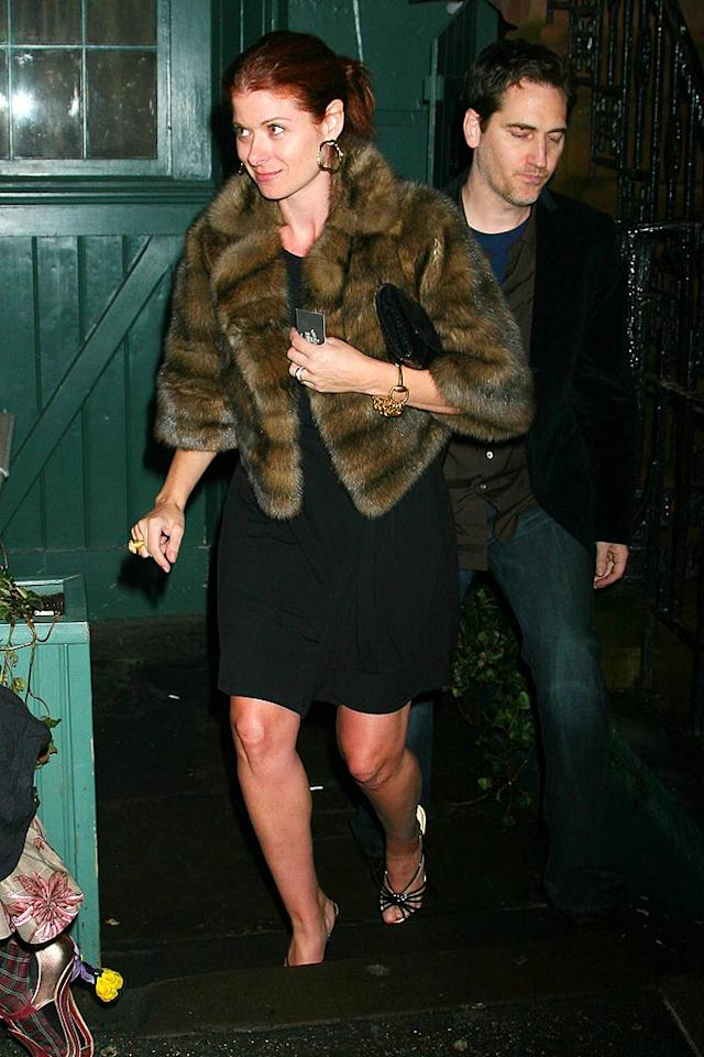"Debra Messing exits the Waverly Inn, NYC's famed eatery best known for its intimate atmosphere, $55 truffle-infused mac and cheese, and its celeb clientele. Demis Maryannakis/<a href=""http://www.splashnewsonline.com"" target=""new"">Splash News</a> - February 5, 2008"