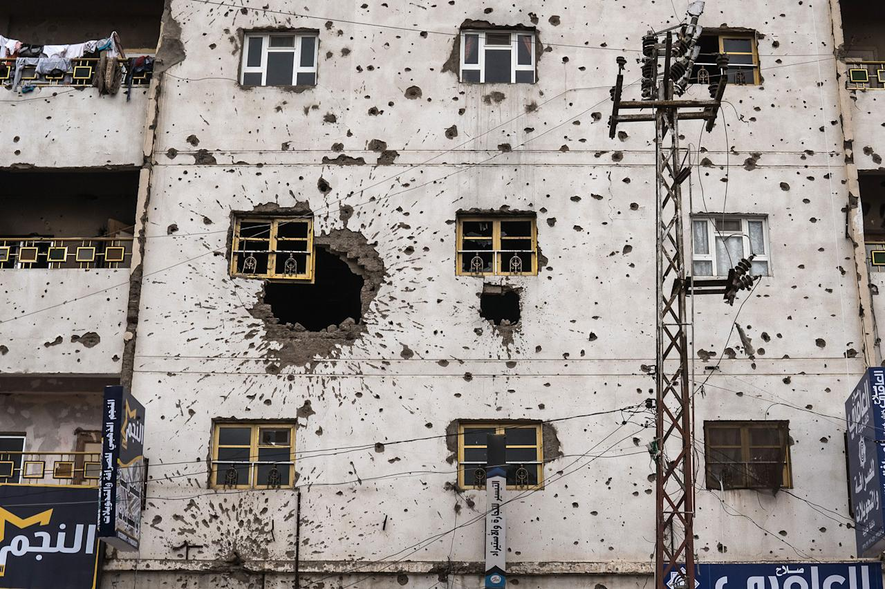 <p>Sana'a building facade,Sana'a, Yemen April 29, 2017: A building damaged by ground fighting and gunfire during conflict in 2011. (Photograph by Giles Clarke for UN OCHA/Getty Images) </p>