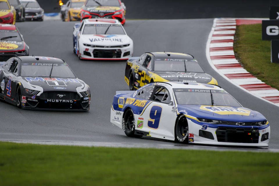 Chase Elliott (9) leads the way out of Turn 7 in a NASCAR Cup Series auto race at Charlotte Motor Speedway in Concord, N.C., Sunday, Oct. 11, 2020. (AP Photo/Nell Redmond)