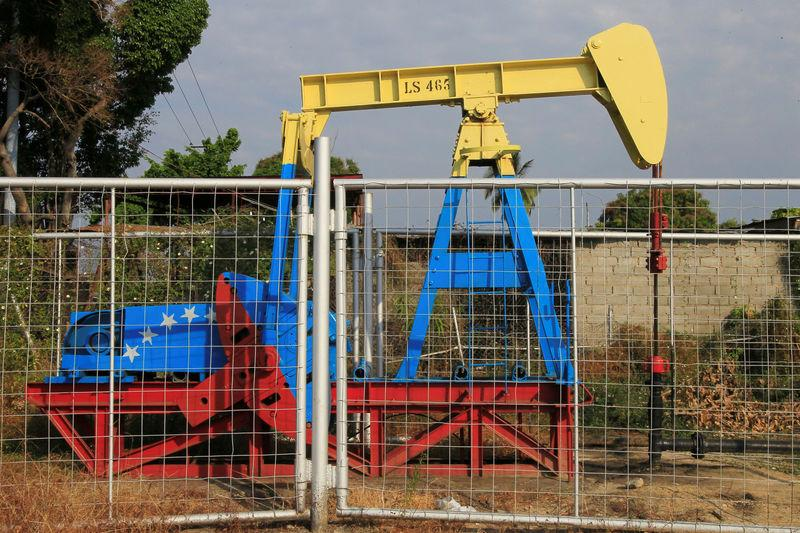FILE PHOTO: An oil pumpjack painted with the colors of the Venezuelan flag is seen in Lagunillas