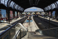 A view of the nearly empty platforms at Hamburg Central Station shortly before the start of the nightly curfew, which begins at 9 p.m. in Hamburg, Germany, Saturday, April 24, 2021. Beginning Saturday, a federal emergency curfew rule will apply to counties with a seven-day incidence of more than 100 new coronavirus infections. This includes, but is not limited to, curfew restrictions between 10 p.m. and 5 a.m. (Georg Wendt/dpa via AP)