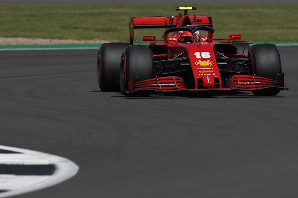 <p>Ferrari's Monegasque driver Charles Leclerc steers his car during the qualifying session for the Formula One British Grand Prix at the Silverstone motor racing circuit in Silverstone, central England on August 1, 2020</p>