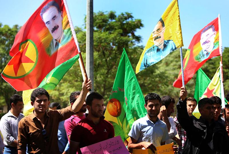 Iraqi Kurdish supporters of the Kurdistan Workers Party (PKK) hold flags bearing portraits of jailed PKK leader Abdullah Ocalan during a rally in Arbil on April 12, 2014 (AFP Photo/Safin Hamed)