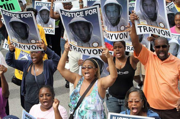 PHOTO: Thousands of demonstrators march along W. 13th Street in Sanford, Florida, during a NAACP rally and march demanding for justice in the shooting of Trayvon Martin, March 31, 2012. (Gary W. Green/Orlando Sentinel/Tribune News Service via Getty Images)