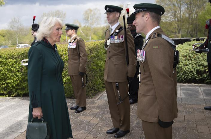 The Duchess of Cornwall meets Lieutenant Colonel Jim Hadfield MBE during her first visit to 5th Battalion The Rifles, following her new appointment as Colonel-in-Chief, at Bulford Station in Wiltshire. Picture date: Friday May 7, 2021.