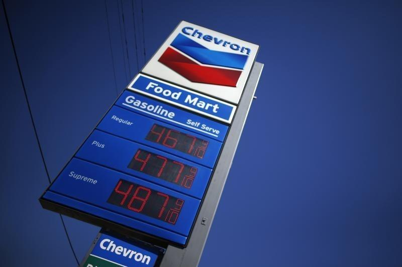 A sign advertising gas prices is seen at a Chevron station in Los Angeles