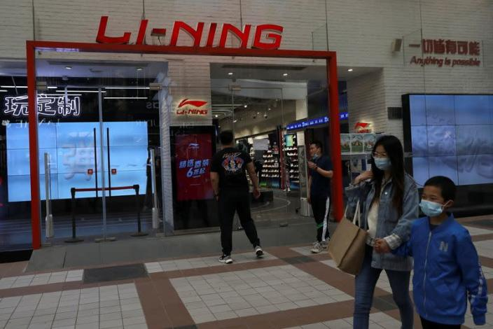 People walk past a store of Chinese sports products brand Li Ning in Beijing