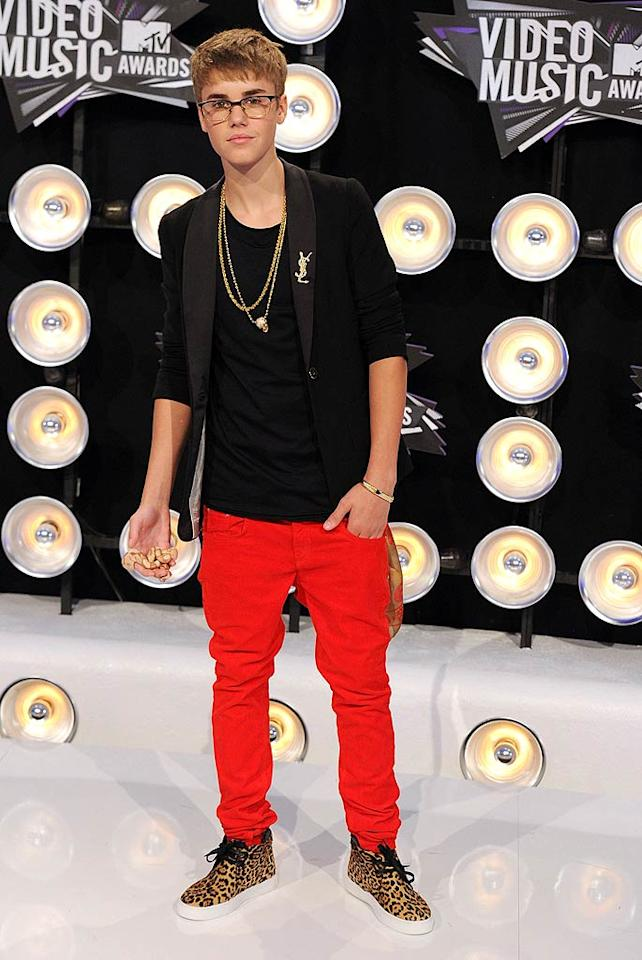 "Selena's boyfriend, Justin Bieber -- who, to our knowledge, has perfect vision -- unsuccessfully attempted to look cool in some specs. His other accessories included an Yves St. Laurent brooch and cheetah print kicks. Are you feeling the teen titan's getup? We certainly aren't. Steve Granitz/<a href=""http://www.wireimage.com"" target=""new"">WireImage.com</a> - August 28, 2011"