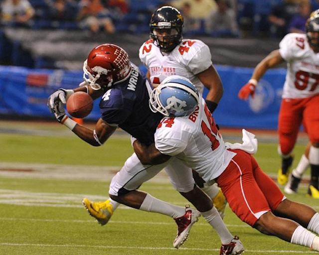ST. PETERSBURG, FL - JANUARY 21: Wide receiver Jarius Wright #4 of the University of Arkansas Razorbacks bobbles a pass during the 87th annual East-West Shrine game January 21, 2012 at Tropicana Field in St. Petersburg, Florida. (Photo by Al Messerschmidt/Getty Images)